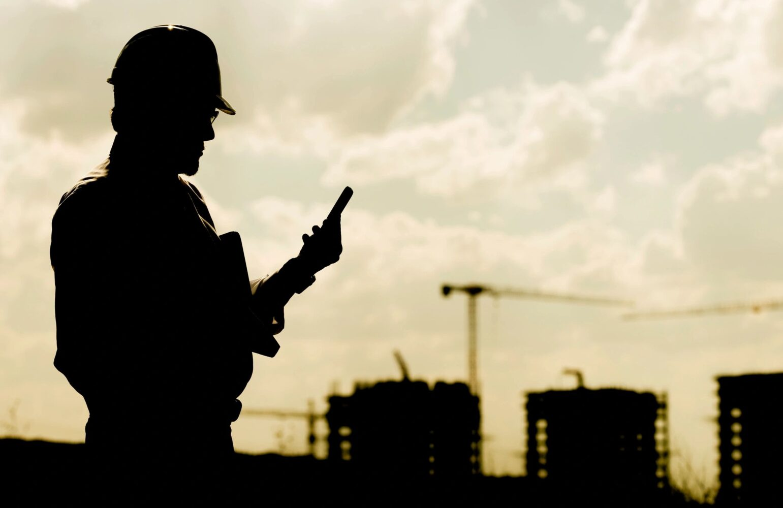 frontline worker holding phone